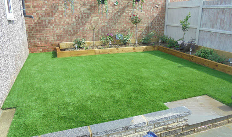 Adding artificial grass to a redesigned lawn in orpington for Redesign your garden