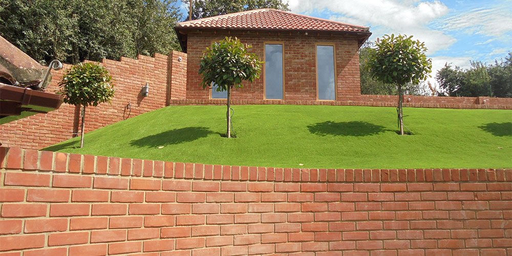 Artificial Grass on a Slope Installed