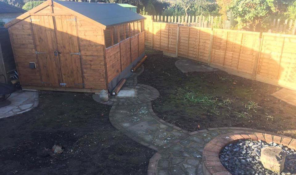 Shed and dirt lawn