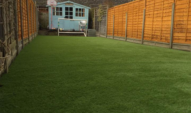 Fitting artificial grass in Hertford