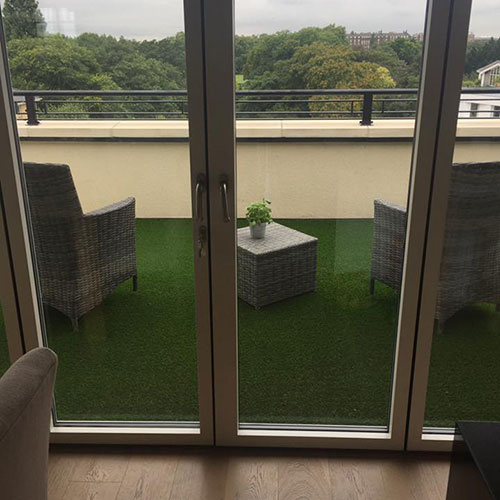 Looking out onto grassed balcony