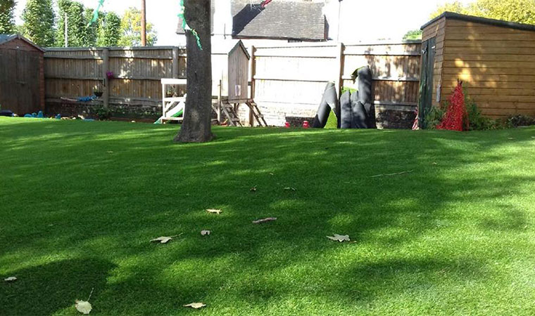 Completed artificial grass play area pratts bottom