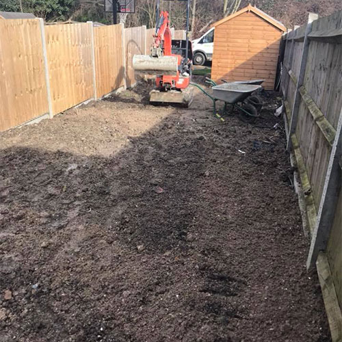 Removing top soil and levelling lawn