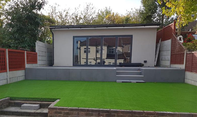Garden office surrounded by artificial grass