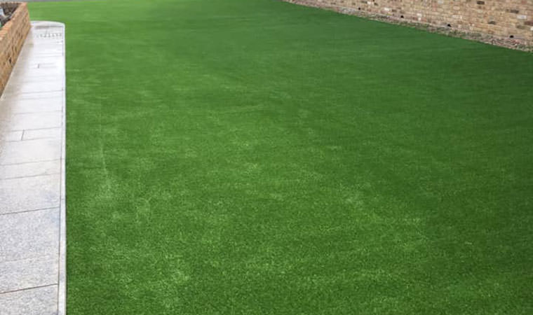 Swimming pool roof covered with artificial grass