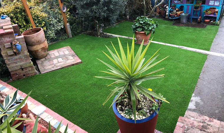 Artificial grass fitted two tier lawn