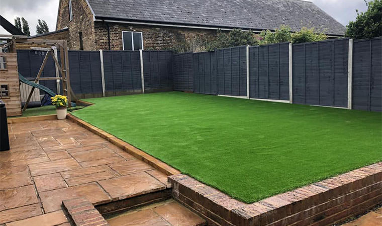 Levelled lawn with artificial grass