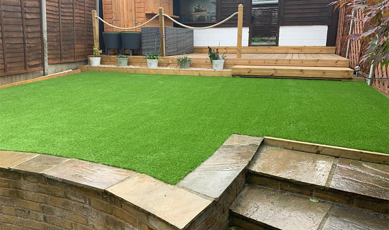 Artificial grass added to middle layer of lawn